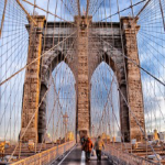 Walking over the Brooklyn Bridge.