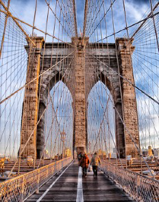 Walking over the Brooklyn Bridge.